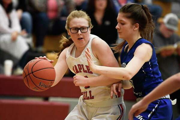 Maple Hills Paige Bleau, left, moves the ball past Hoosic Valley's Anna Jensen during a girls' Section II Class C high school semifinal basketball game Tuesday, March 3, 2020 in Colonie, N.Y. (Hans Pennink / Special to the Times Union)
