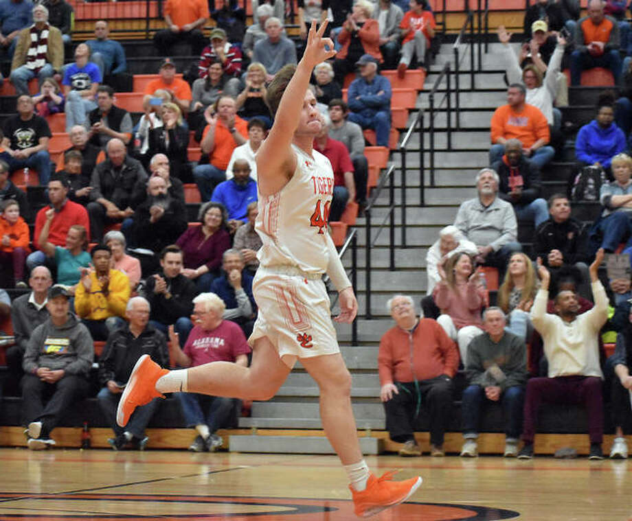 Edwardsville senior Gavin Reames runs down the court celebrating a 3-pointer from Jack Nafziger in the second quarter of Tuesday's win over Quincy in the Class 4A Edwardsville Regional semifinals.