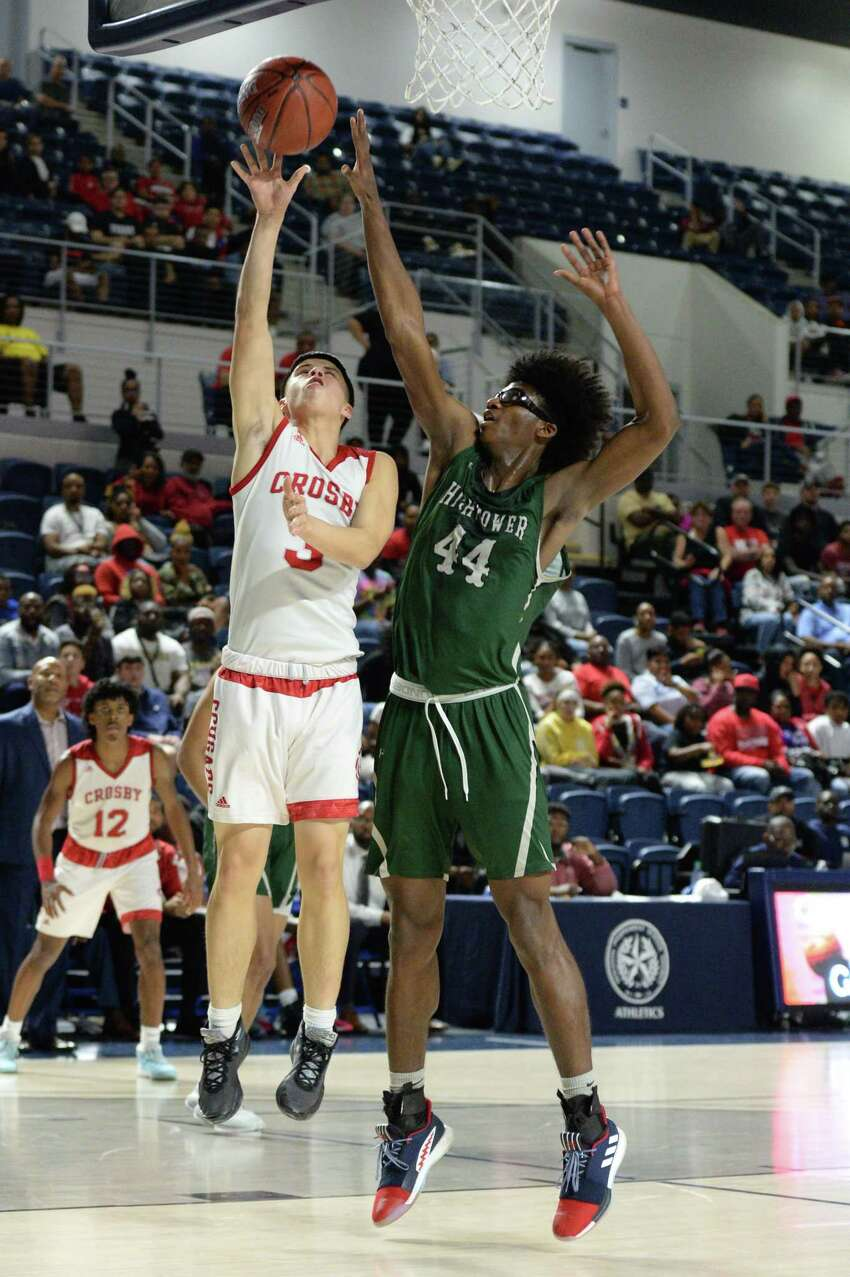 Giovanni Saldana (3) of Crosby attempts a shot as Ja Robertson (44) of Hightower defends during the fourth quarter of the Boys 5A Region III Quarterfinal basketball game between the Hightower Hurricanes and the Crosby Cougars on Tuesday, March 3, 2020 at Delmar Fieldhouse, Houston, TX.