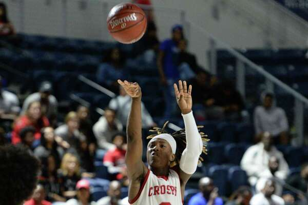 Deniquez Dunn (2) of Crosby attempts a jump shot during the fourth quarter of the Boys 5A Region III Quarterfinal basketball game between the Hightower Hurricanes and the Crosby Cougars on Tuesday, March 3, 2020 at Delmar Fieldhouse, Houston, TX.