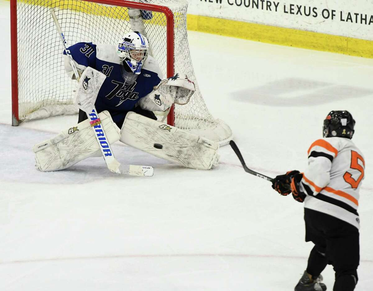 Bethlehem's William Bievenue shoots the puck at Saratoga goaltender Brad Blake during the Division 1 Sectional Championship at Union College in Schenectady, N.Y., Tuesday, Mar. 3, 2020. (Jenn March, Special to the Times Union)