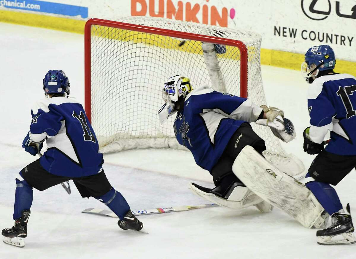 A shot flies in past Saratoga goalie Brad Blake as defensemen look on during the Division 1 Sectional Championship against Bethlehem at Union College in Schenectady, N.Y., Tuesday, Mar. 3, 2020. (Jenn March, Special to the Times Union)