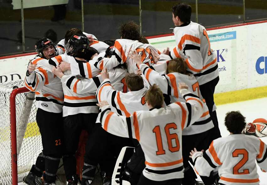 Bethlehem hockey players swarm the net after winning the Division 1 Sectional Championship against Saratoga at Union College in Schenectady, N.Y., Tuesday, Mar. 3, 2020. (Jenn March, Special to the Times Union)