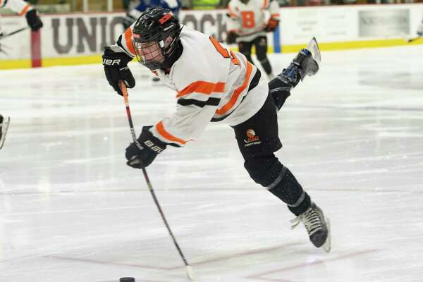 Bethlehem's Justin Chenaille loses his footing as he shoots the puck on the Saratoga net during the Division 1 Sectional Championship at Union College in Schenectady, N.Y., Tuesday, Mar. 3, 2020. (Jenn March, Special to the Times Union)