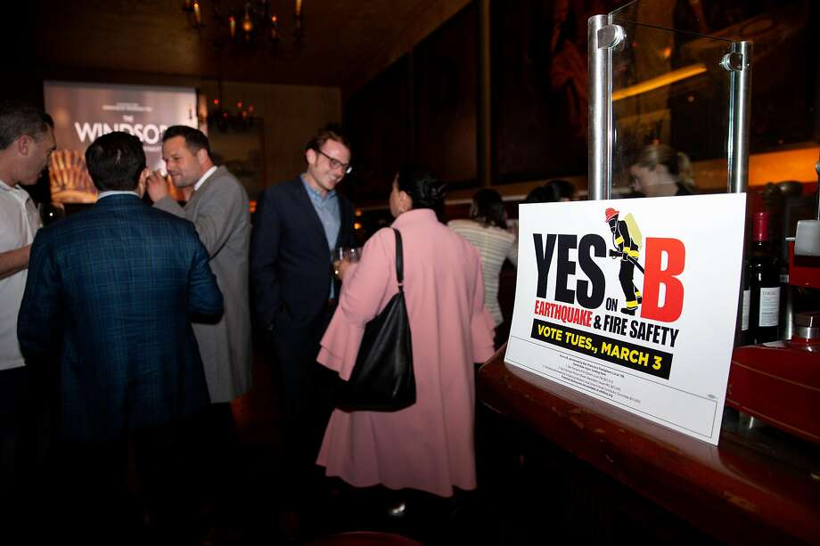 People at the election-night party for Proposition B at Tosca Cafe in San Francisco should be happy as the measure passed easily. Photo: Santiago Mejia / The Chronicle