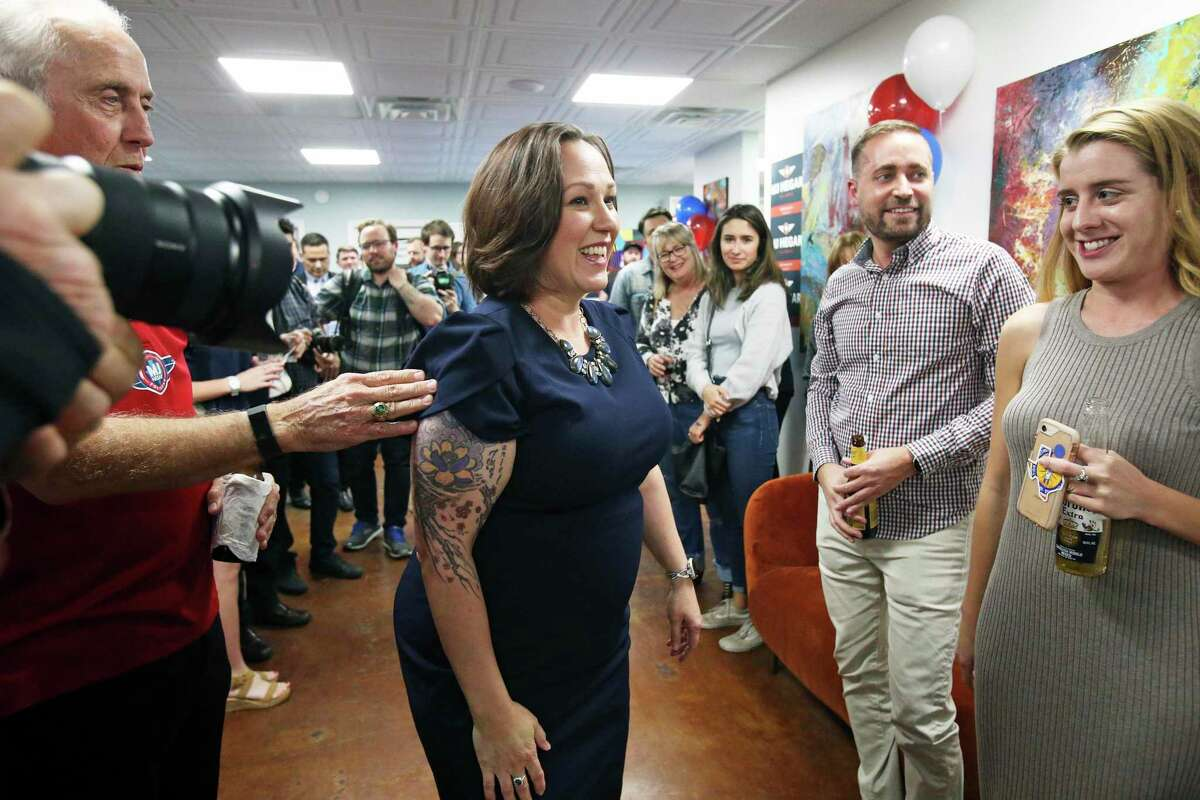 Democratic U.S. Senate candidate MJ Hegar visits with her supporters after the polls close at the offices of The Riveter in Austin on Feb. 2, 2020.