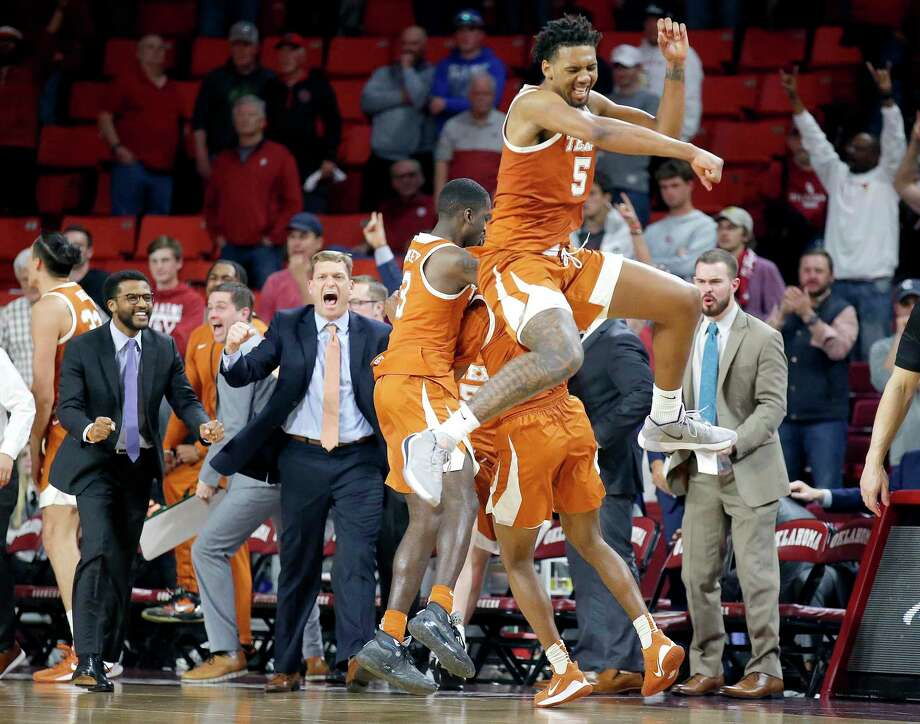 Matt Coleman's 3-pointer with 0.4 seconds remaining has Royce Hamm jumping for joy and Texas in a much better position to squeeze its way into the NCAA field. Photo: SARAH PHIPPS, MBR / Associated Press / SARAH PHIPPS/THE OKLAHOMAN