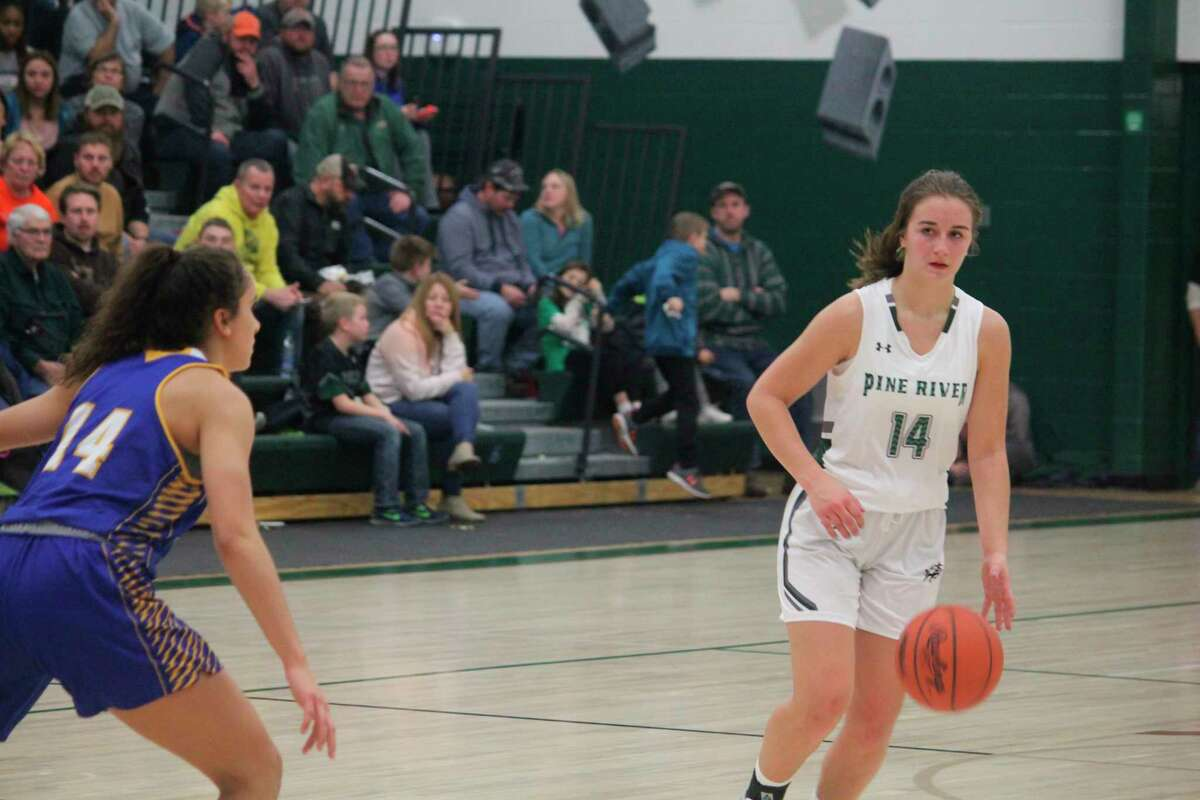 Madi Sparks (14) gets set to make a play for Pine River in recent action. (Herald Review/John Raffel)