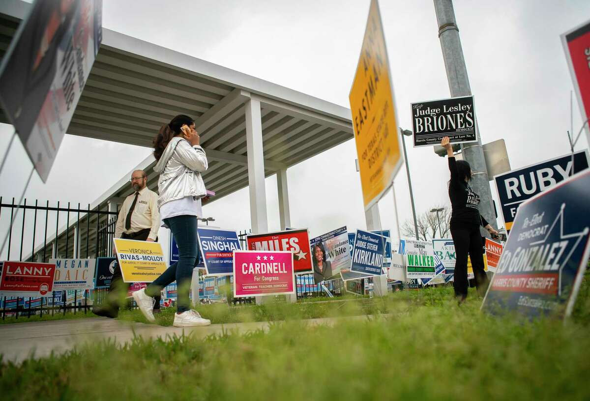 Campaign workers greet voters Tuesday morning, March 3, 2020, at the Metropolitan Multi-Service Center on West Gray in Houston.
