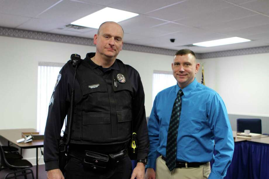 Interim Reed City Police Chief Brian Koschmider, left, welcomes Officer Chris Lockhart as the newly appointed chief of police. Lockhart was approved in a unanimous vote by city council Feb. 28, and will assume the duties of police chief in a couple of weeks. (Herald Review photo/Cathie Crew)