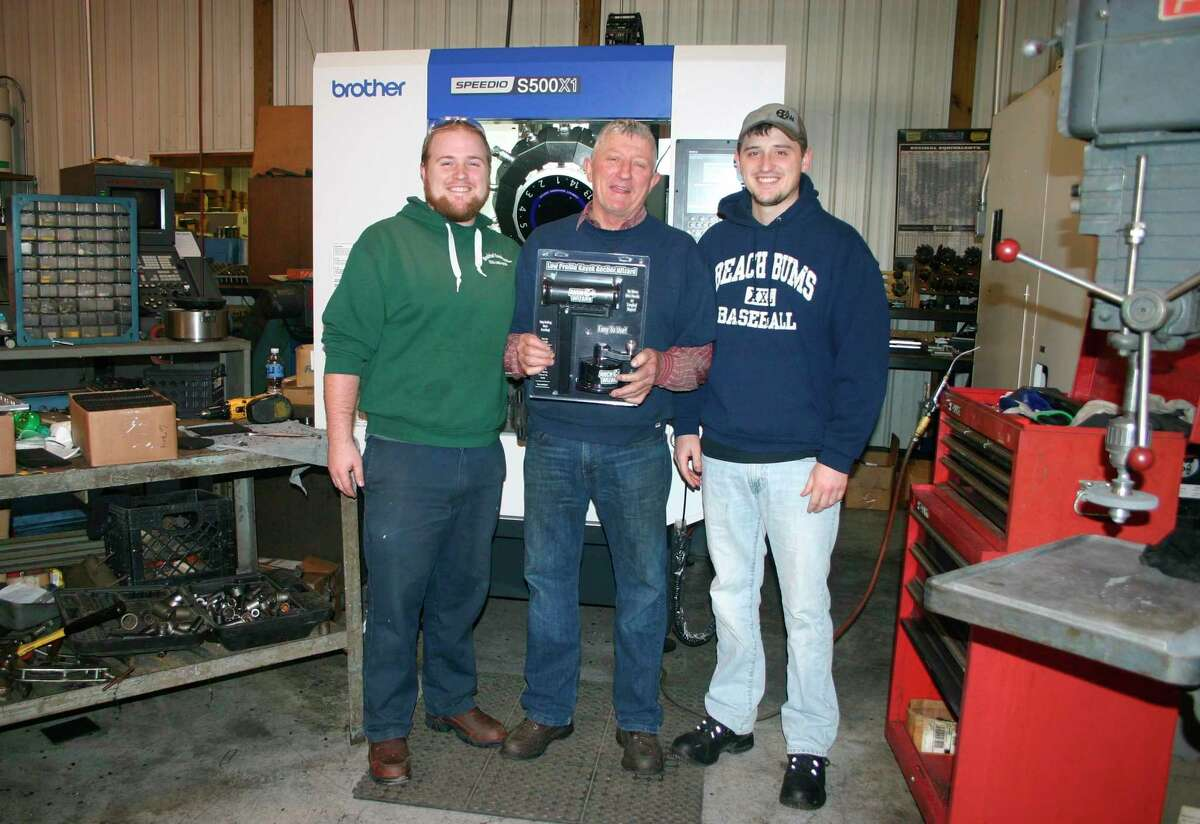 Anchor Wizard in Evart is owned and operated by the VanScoyoc family. Pictured (from left) are Keevin, Bruce ad Kameron VanScoyoc. Bruce VanScoyoc invented the anchor tiller system for fishing boats in 2005, which launched Anchor Wizard. The company has since developed the Kayak Anchor Wizard, specifically for kayak fishing. (Herald Review photo/Cathie Crew)