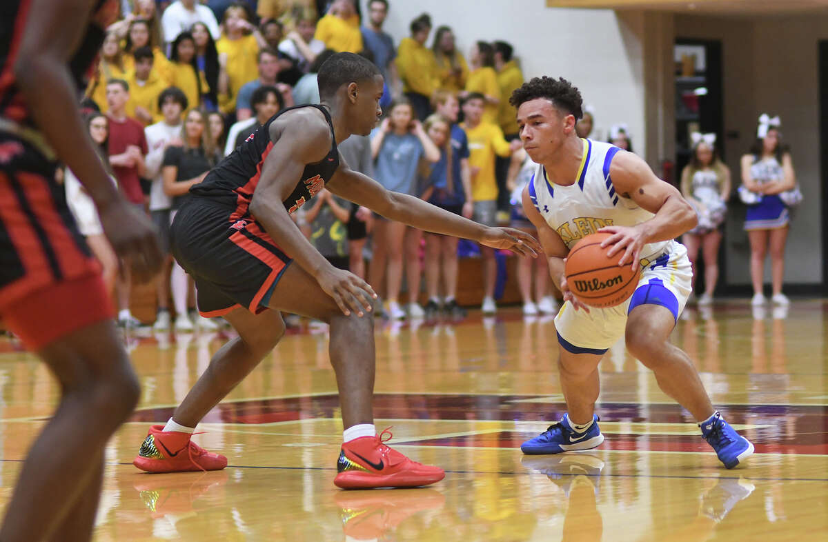 Klein senior guard Tyson Thompson, right, works the ball against Westfield senior Tyson Anderson, left, during the first quarter of their Boys Basketball Region II-6A Quarterfinal playoff game at Tomball High School on March 3, 2020.