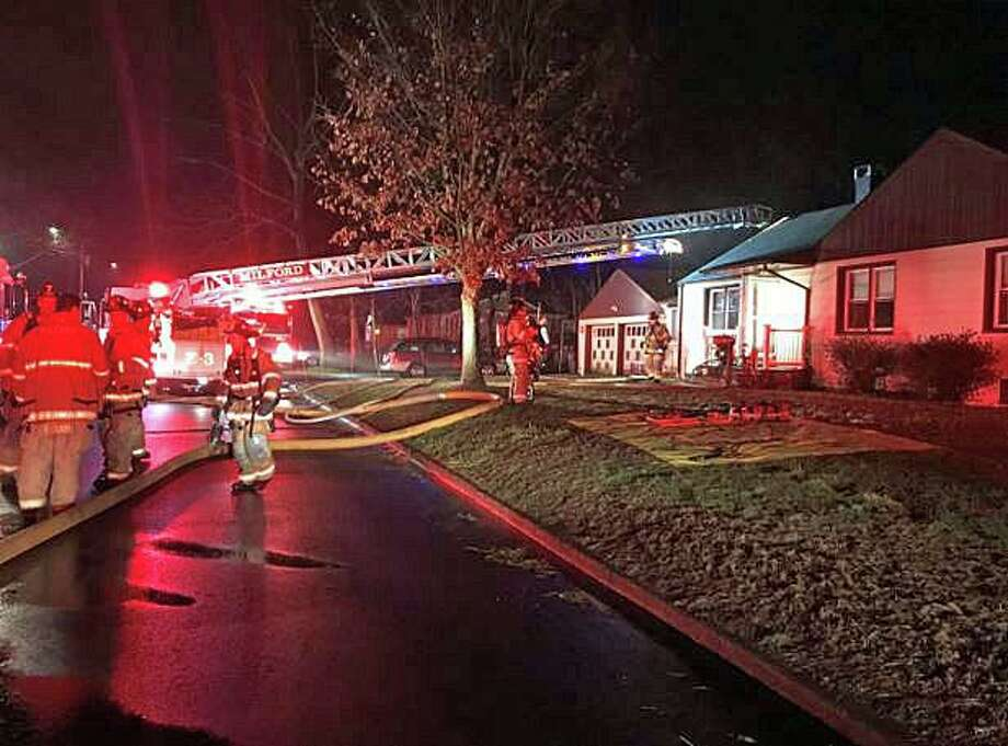 Two small dogs were rescued by Milford firefighters after an intense kitchen fire broke out in an Elizabeth Street house Tuesday evening on March 3, 2020. The call came in at 7:51 p.m. from the Standard Alarm monitoring company for a smoke detector activated in a hallway in the single-family home. The owner, who is deaf, did not hear the alarm from the smoke detector, but luckily had a hard-wired system that is monitored by a 24-hour service. There were no injuries reported. The kitchen sustained extensive damage and the rest of the house had heavy smoke and heat damage. Photo: Milford Fire Department Photo