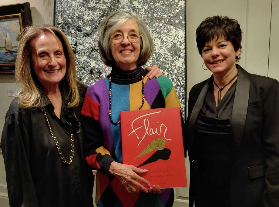 Suzanne Simpson (center) receives the John Tatge Memorial Volunteer of the Year Award from the Art Society of Old Greenwich on Feb. 21, at its 2020 Winterfest dinner and art show, held at the Riverside Yacht Club in Greenwich. ASOG Co-Presidents Elaine Conner (left) and Julie DiBiase (right) present the award for Simpson's exceptional volunteer service in chairing the 2019 ASOG Sidewalk Show and Sale. Photo: Contributed /