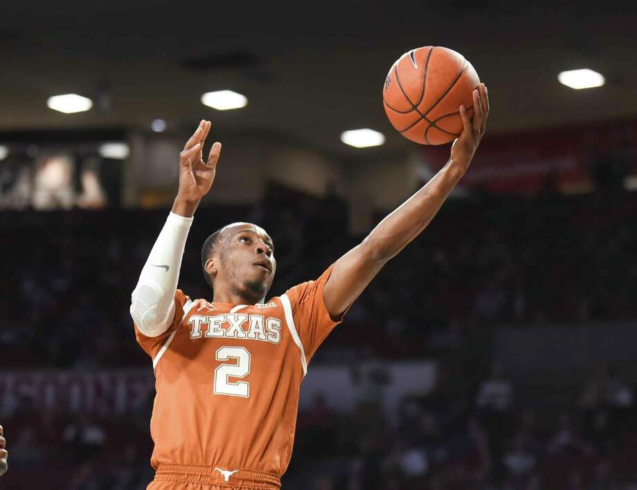 Texas guard Matt Coleman III (2) goes up for a shot during the first half of an NCAA college basketball game against Oklahoma in Norman, Okla., Tuesday, March 3, 2020. (Kyle Phillips/The Norman Transcript via AP) Photo: Kyle Phillips, Associated Press / Copyright 2020 The Associated Press. All rights reserved.