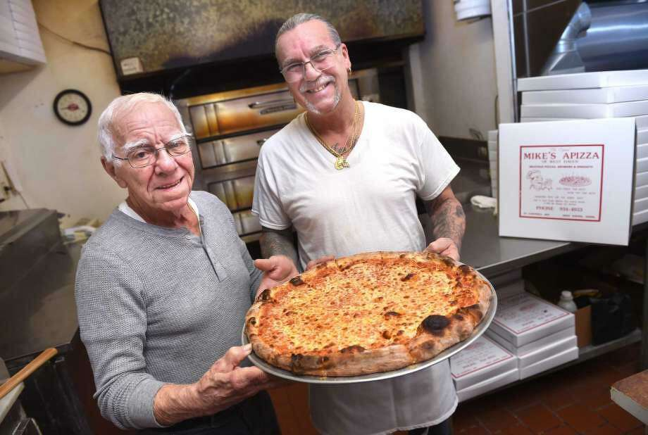 Frank Buonocore, left, co-owner of Mike's Apizza, and his son, Mike, are photographed at their pizza restaurant on Campbell Avenue in West Haven. Photo: Arnold Gold / Hearst Connecticut Media File