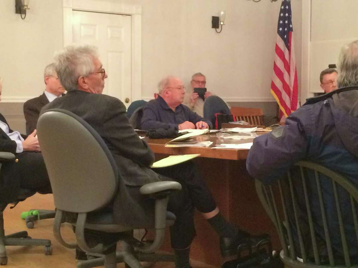 Ethics Commission Chairman Thomas Lee asks former First Selectman Tim Herbst a question during the March 3 hearing.