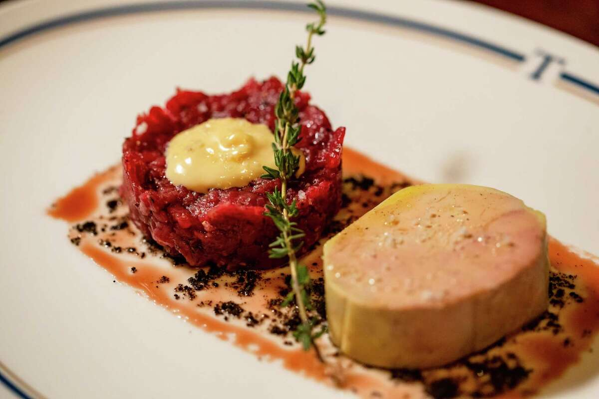 Steak tartare and foie gras torchorn with port wine syrup and mushroom dust at Turner's, a new dining concept from restaurateur Benjamin Berg, featuring a menu from James Beard Award-winning chef Robert Del Grande, at 1800 Post Oak.