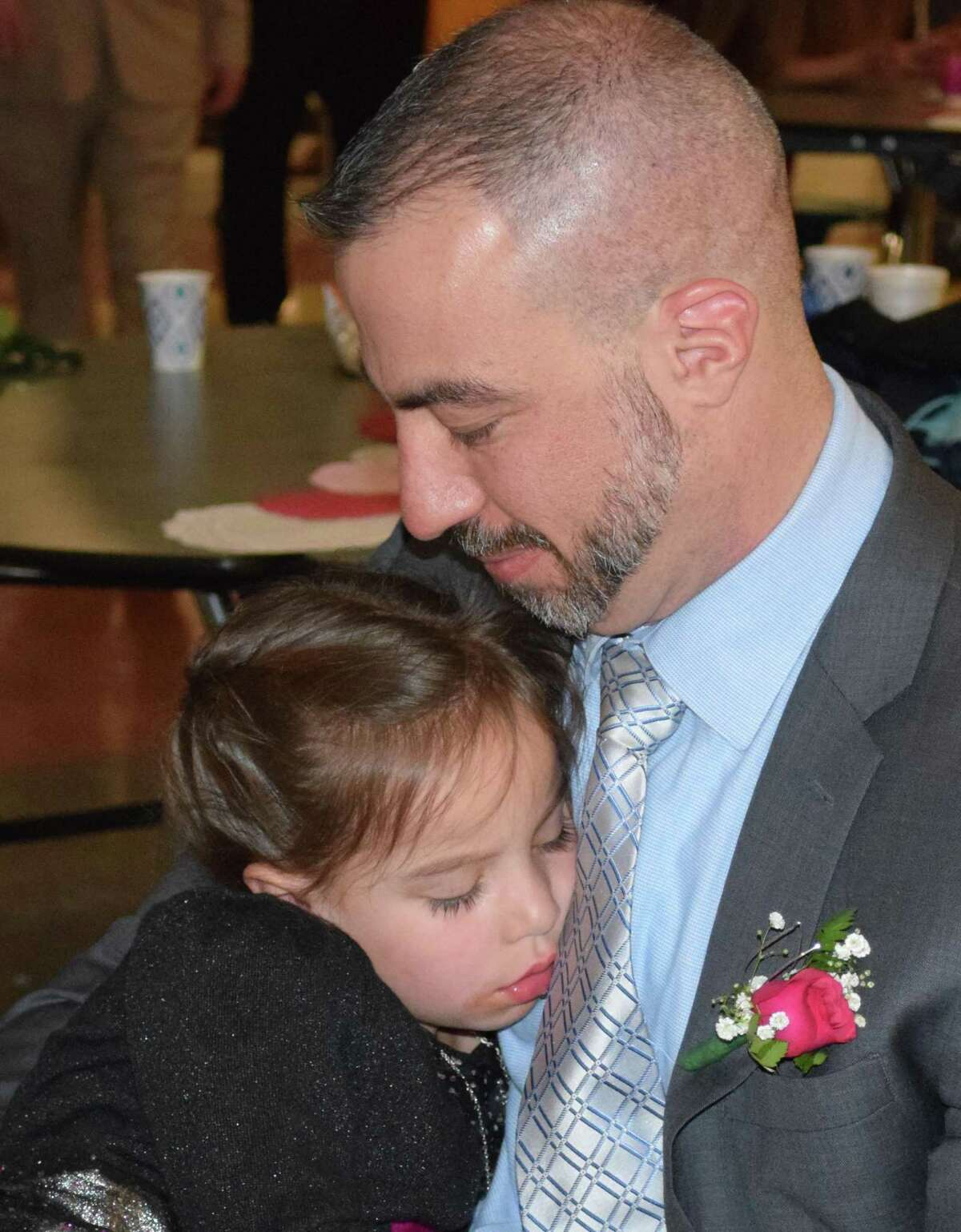 Spectrum/New Milford Girl Scout Troop 40270 hosted the annual Sweetheart Dance at New Milford High School Feb. 22, 2020.The event featured formal photos, a silent auction, dancing, refreshments and more. Above, Harper Allen, 5, of New Milford takes a brief nap on her father, Tom's, lap.
