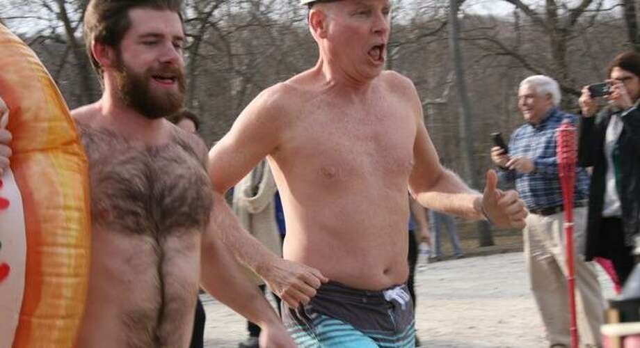 Doug Bogan, left, and Bob McDowell run toward Kiwanis Pond at the Riverbrook Regional YMCA in Wilton for the annual Swamp Romp last year. This year's polar plunge will be on March 7. Photo: Contributed Photo / Riverbrook Regional YMCA / Wilton Bulletin Contributed