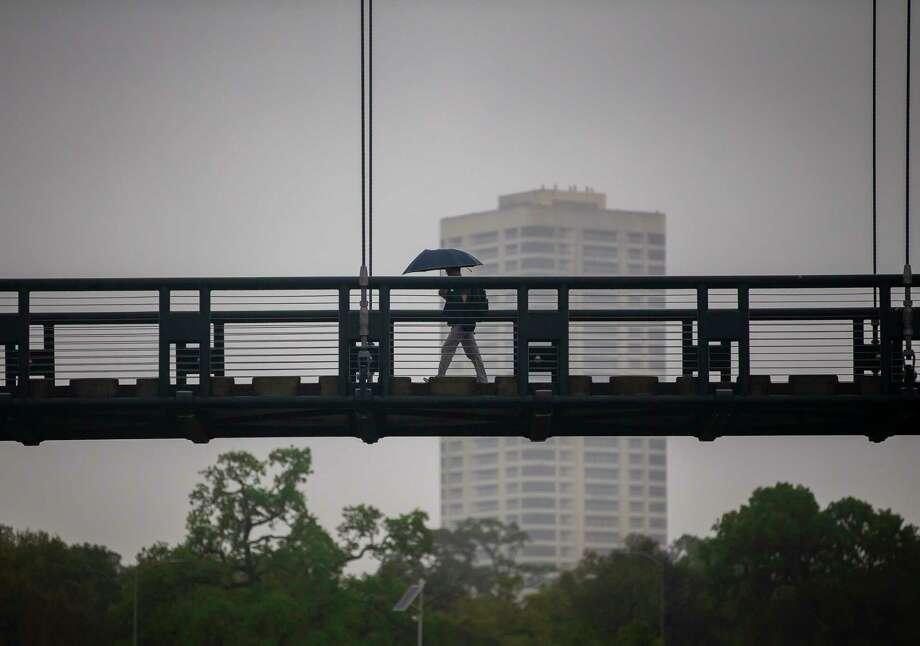 A pedestrian crosses a bridge across Brays Bayou, Wednesday, March 4, 2020, near Hermann Park in Houston. Photo: Mark Mulligan, Staff Photographer / © 2020 Mark Mulligan / Houston Chronicle