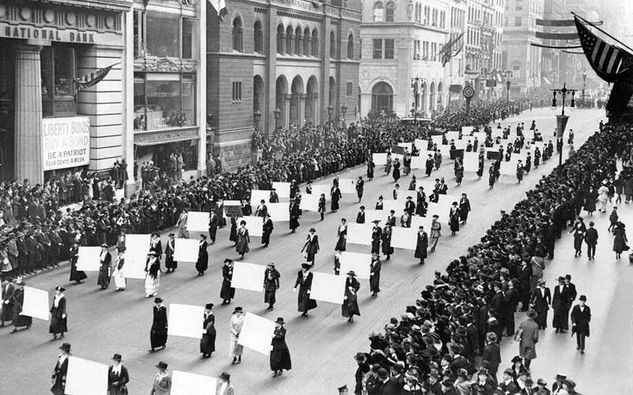 Women's suffrage advocates march down Fifth Avenue in October 1917, displaying placards containing the signatures of more than 1 million New York women demanding the vote. Photo: Photo Courtesy Of The New York Times Photo Archives/Creative Commons