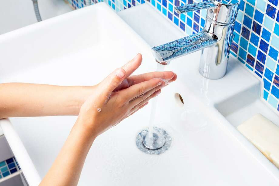 The Town of New Canaan is preparing for the spread of the coronavirus. A girl washes her hands with soap in a bathroom sink. Photo: Dmitry Naumov / Dmitry Naumov - Fotolia / Dmitry Naumov - Fotolia