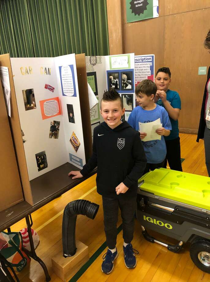 Collin Judkins' Kitty Car Can - created to collect garbage that so often accumulates on the floor of the family car - earned the top prize at the Mohegan School Invention Convention. Photo: Contributed Photos / Connecticut Post