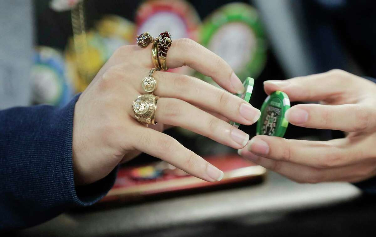 Andrew Vodinh of Houston shuffles his poker chips during a tournament at Paramount Social Club in Houston on Saturday, Feb. 29, 2020.