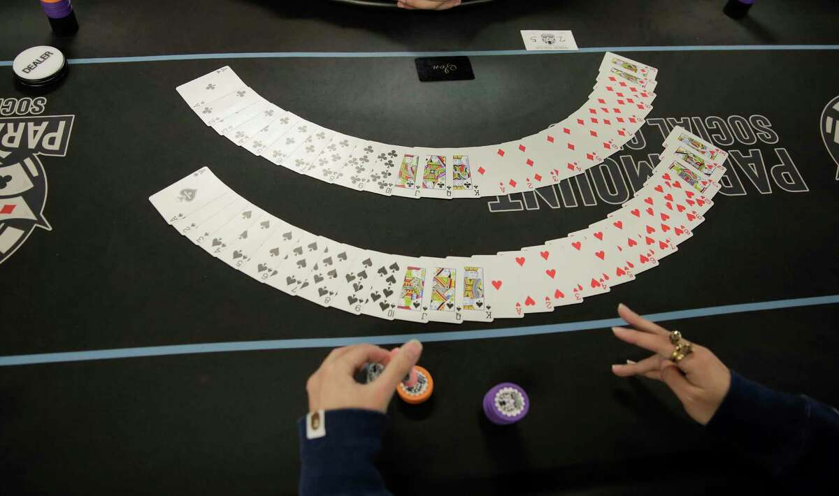 People participate in a poker tournament at Paramount Social Club in Houston on Saturday, Feb. 29, 2020.