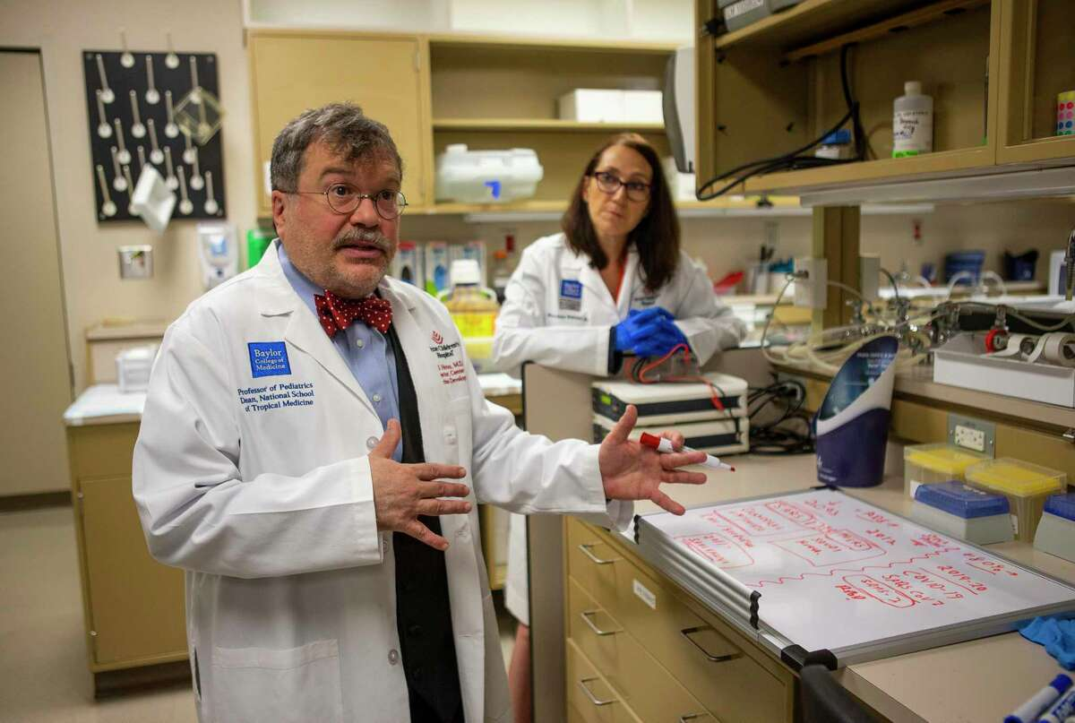 Dr. Peter Hotez and his science partner, Dr. Maria Elena Bottazzi, in their vaccine lab at Texas Children's Hospital Center for Vaccine Development - Baylor College of Medicine, in February 2020.