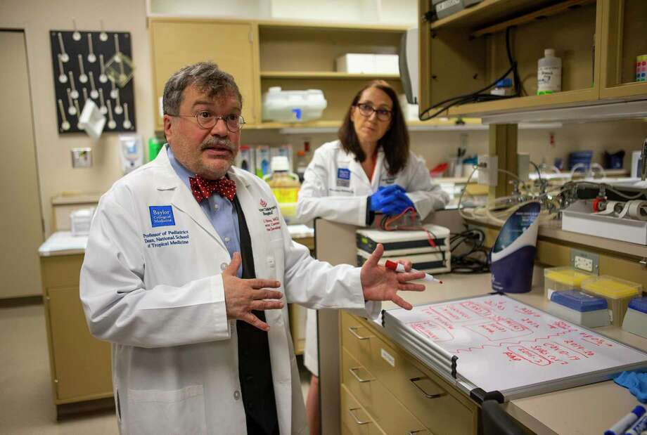 Dr. Peter Hotez and his science partner, Dr. Maria Elena Bottazzi, in their vaccine lab at Texas Children's Hospital Center for Vaccine Development - Baylor College of Medicine, in February 2020. Photo: Mark Mulligan, Houston Chronicle / Staff Photographer / © 2020 Mark Mulligan / Houston Chronicle