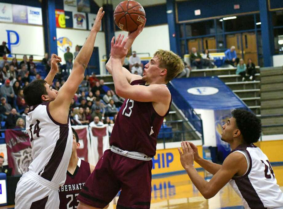 Abernathy's Bryson Daily puts up a shot between Littlefield defenders during their Class 3A regional quarterfinal boys basketball game on Tuesday, March 3, 2020 at Frenship High School. Photo: Nathan Giese/Planview Herald