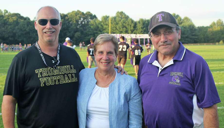 Trumbull High head football coach Marce Petroccio, First Selectman Vicki Tesoro and Trumbull Pop Warner President Gene Cellini, Sr. Get together at the 48th Trumbull Pop Warner Pep Rally. Photo: Contributed Photo / Joe Vecchione / Trumbull Times
