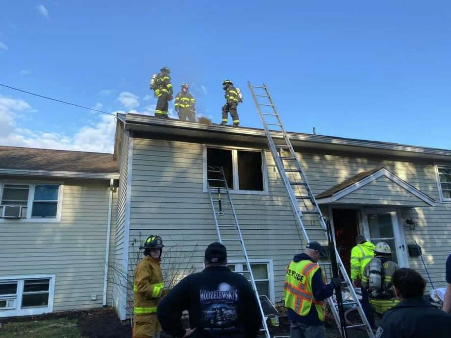 Firefighters respond to a fire at 23 Sunny Valley Road in New Milford, Conn., the morning of March 4, 2020. Photo: Justin DiBiase
