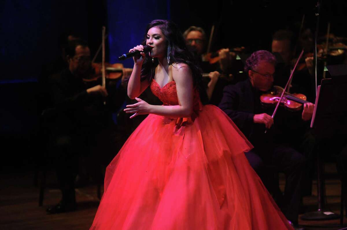 Isabel Marie Sanchez sings during the Houston Symphony's tribute to Selena.