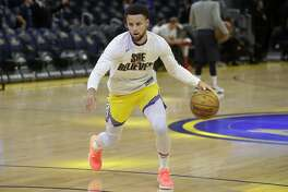 Injured Golden State Warriors guard Stephen Curry warms up before his team's NBA basketball game against the Washington Wizards in San Francisco, Sunday, March 1, 2020. (AP Photo/Jeff Chiu)