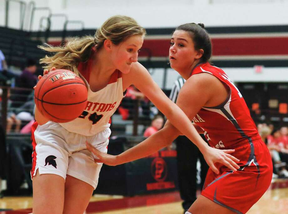 In this file photo, Porter forward Emily Knollenberg (20) drives past Splendora guard Mykala Moore (12) toward the basket during the first quarter of a non-district high school basketball game at Porter High School, Tuesday, Nov. 26, 2019, in Porter. Photo: Jason Fochtman, Houston Chronicle / Staff Photographer / Houston Chronicle