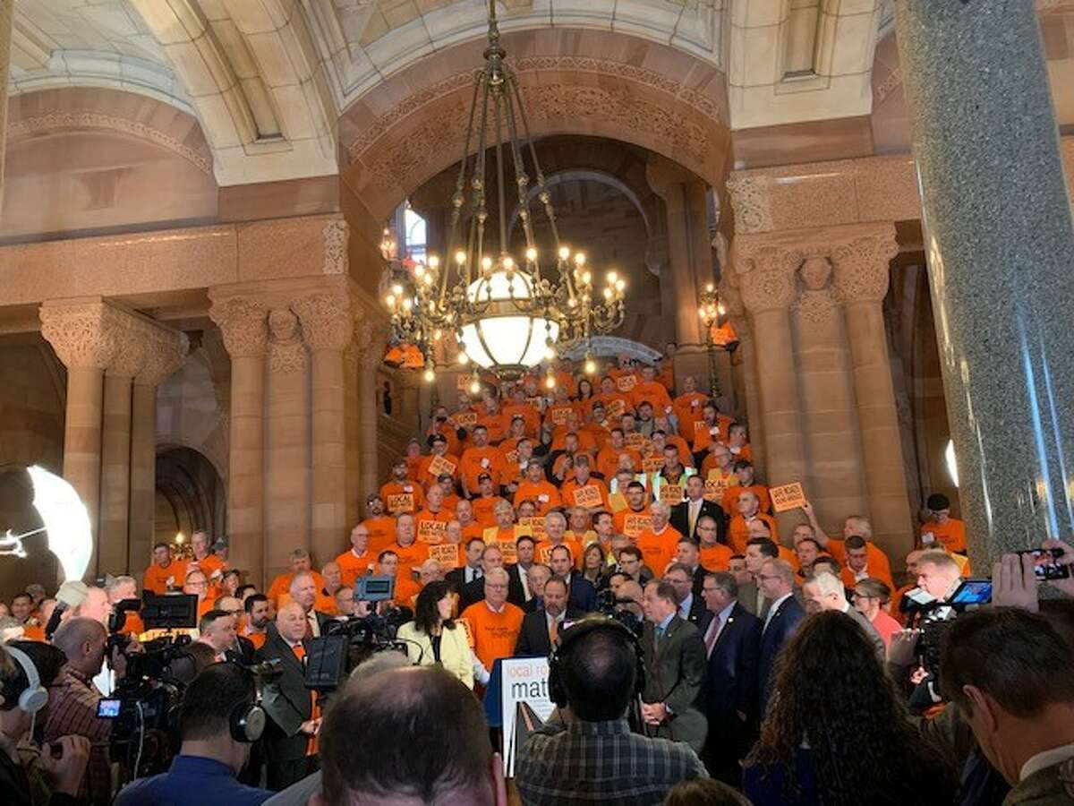 Hundreds of men and women gather on the Million Dollar staircase at the state Capitol on Wednesday, March 4, 2020, calling on the state to increase funding to state's Consolidated Local Street and Highway Improvement Program (CHIPS). (Amanda Fries / Times Union)