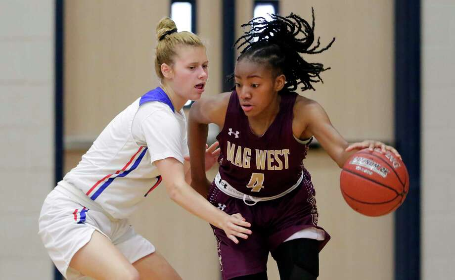 Oak Ridge's Nikki Petrakovitz, left, was named the Most Valuable Player in District 15-6A. The Lady War Eagles finished 29-5 overall, won the district outright and won a playoff game. Photo: Michael Wyke / Contributor / © 2019 Houston Chronicle