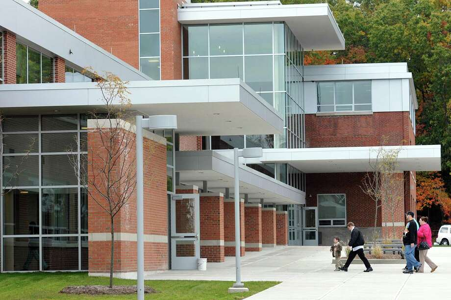 Cas101024 10/24/10 Shelton-- People walk into the front entrance at Perry Hill School for the addition and alterations project dedication ceremony. -Photo/Peter Casolino ***