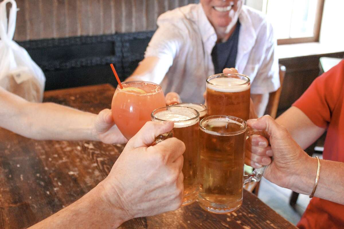 A group from Amy Koren-Roth's food tours says cheers to the weekend. (Photo by Jess Lang)