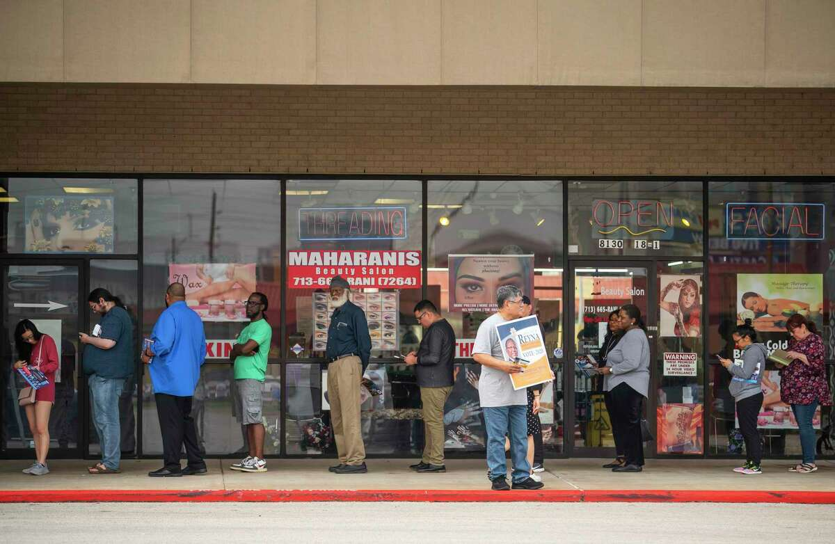 Voters wait to cast their ballots, Tuesday morning, March 3, 2020, at the Fiesta on Kirby in Houston.