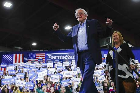 Democratic presidential candidate Sen. Bernie Sanders, I-Vt., accompanied by his wife Jane O'Meara Sanders, arrives at a primary night election rally in Essex Junction, Vt., Tuesday, March 3, 2020. (AP Photo/Matt Rourke)