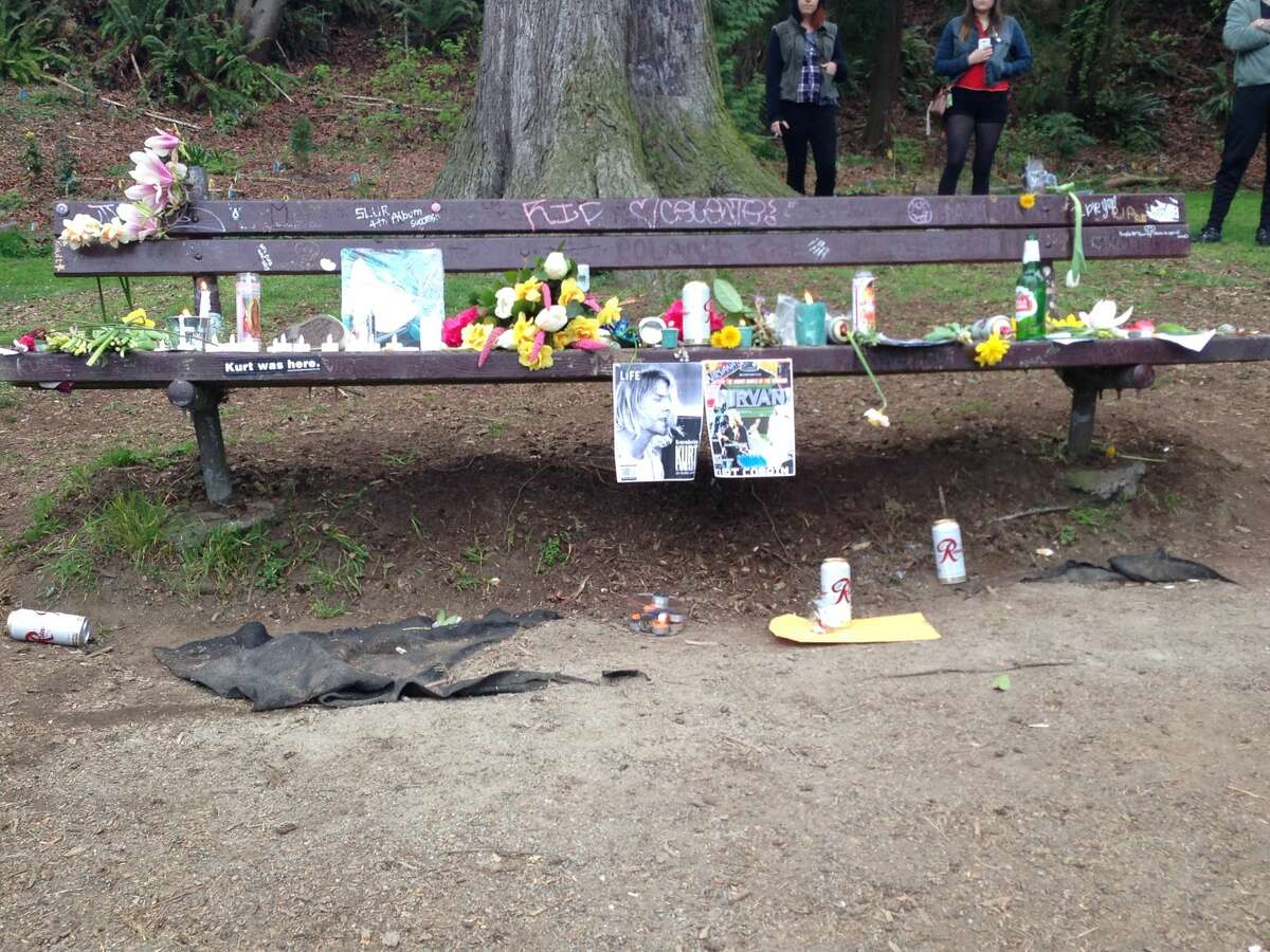 Nestled under the shade of Viretta Park, next to Kurt Cobain's former home, fans have designated an unofficial memorial to the musician. Atop the benches, visitors can find flowers, letters, lyrics, and poems left behind for the Nirvana frontman on what they believe to be a place he would originally sit to write lyrics and find alone time.