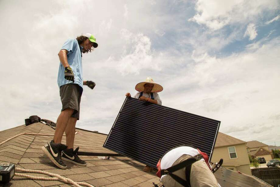 Workers install solar panels on a home in Katy in 2017. Texas is a leader in wind, oil and gas production, and the time has come to lead on solar, too. Photo: David A. Funchess /David A. Funchess / Houston Chronicle