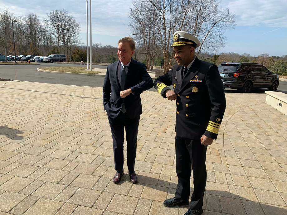 Gov. Ned Lamont and U.S. Surgeon General Dr. Jerome Adams demonstrate how to elbow bump, instead of shake hands, to help prevent spread of the coronavirus. Photo: / Office Of Gov. Lamont