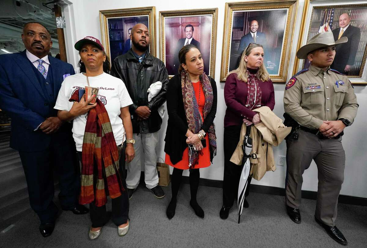 People attend the Texas Southern University board of regents meeting Thursday, Feb. 19, 2020 in Houston. The board motioned to accept the proposal presented in mediation, which finalized the end for Austin Lane as TSU president.