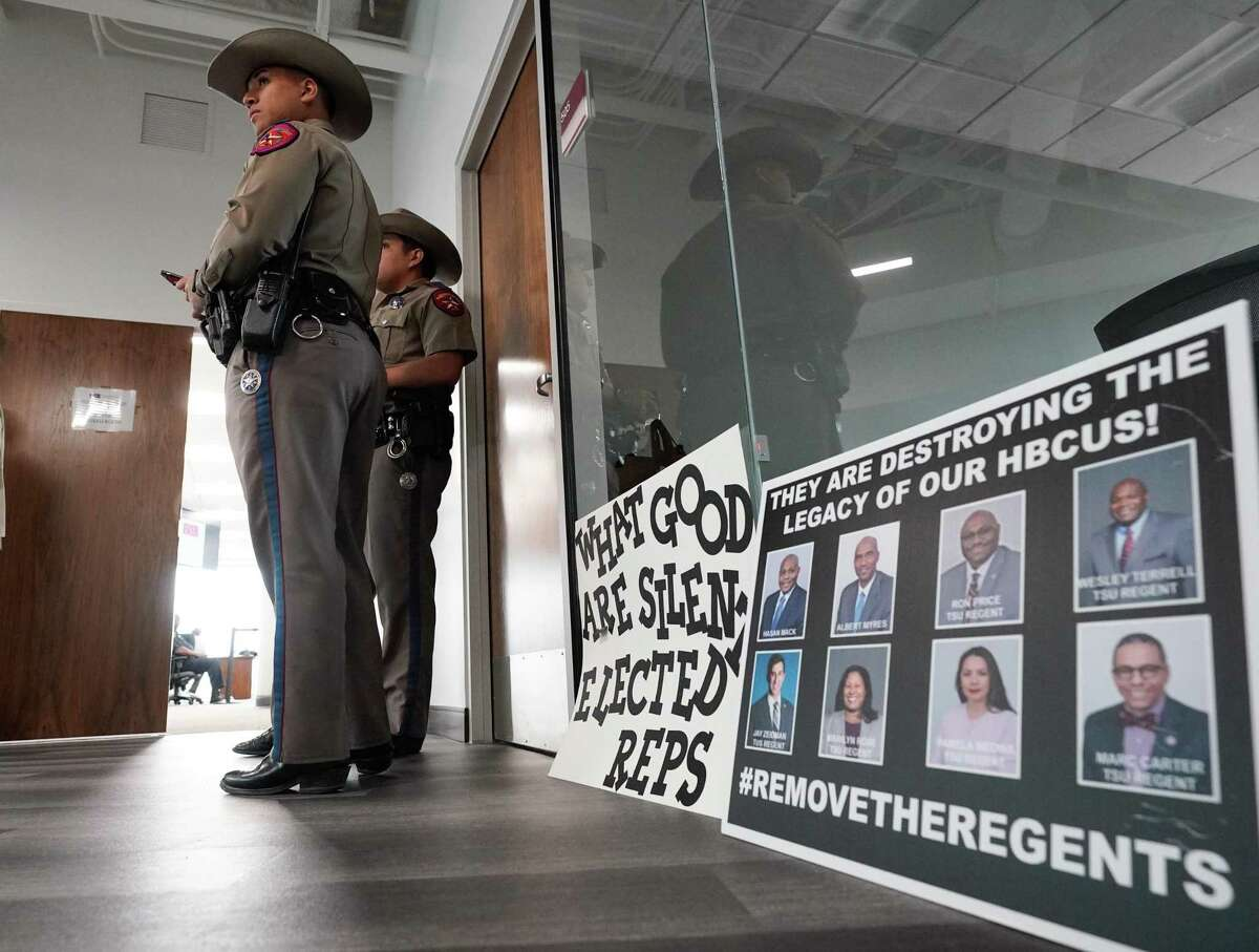 Texas State Troopers stand outside of Texas Southern University board of regents meeting Thursday, Feb. 19, 2020 in Houston. The TSU board is meeting for the first time since giving their notice of termination for sidelined TSU president Austin Lane earlier this month.