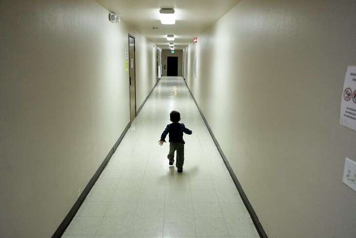 In this Dec. 11, 2018 file photo, an asylum-seeking boy from Central America runs down a hallway after arriving from an immigration detention center to a shelter in San Diego. Advocates say the Trump administration is now fast-tracking the legal proceedings of thousands of immigrant children in its care, including unveiling a pilot program in Houston to stream their hearings through video technology.